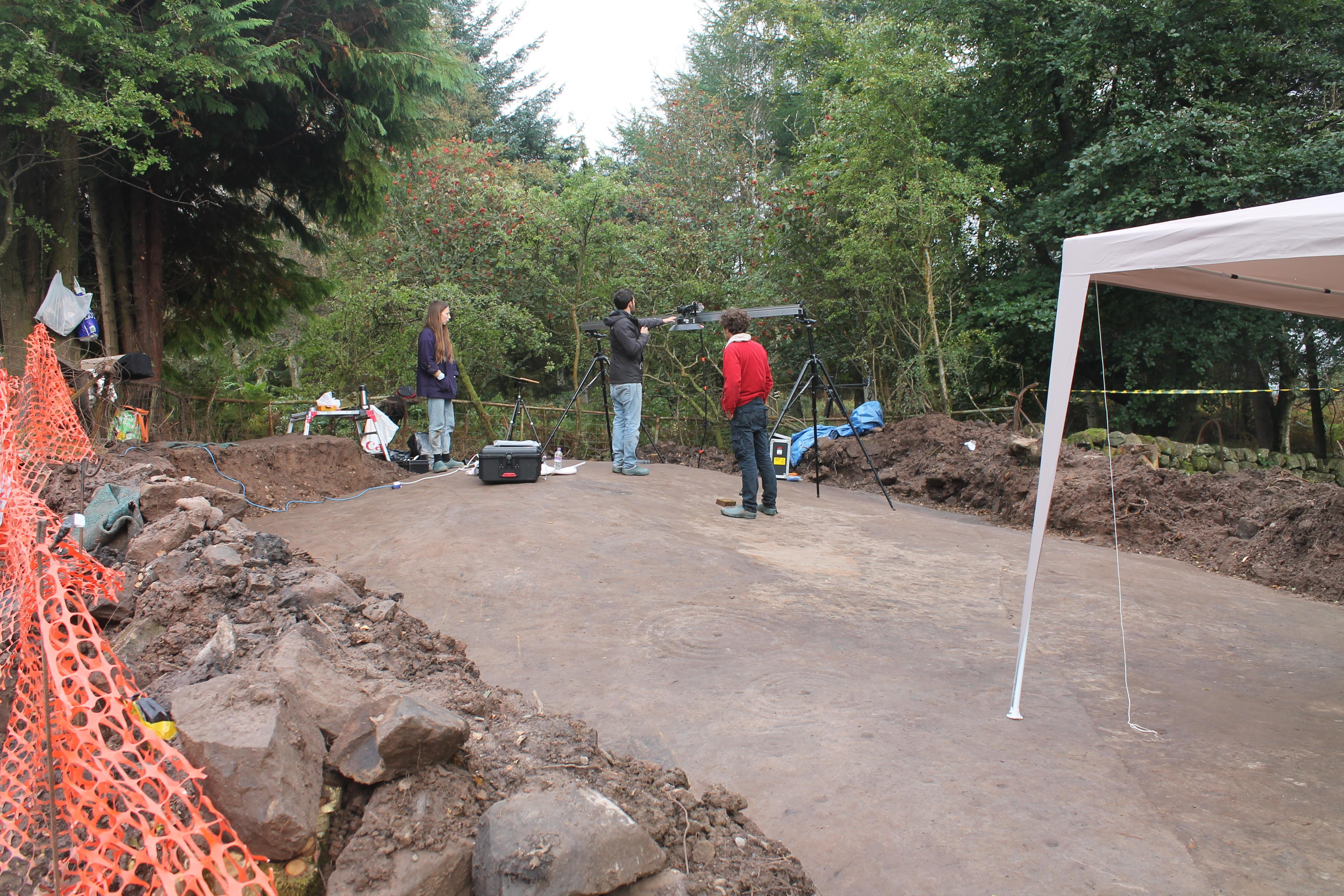 Team of Archeoligists digging for rock art in Faifley
