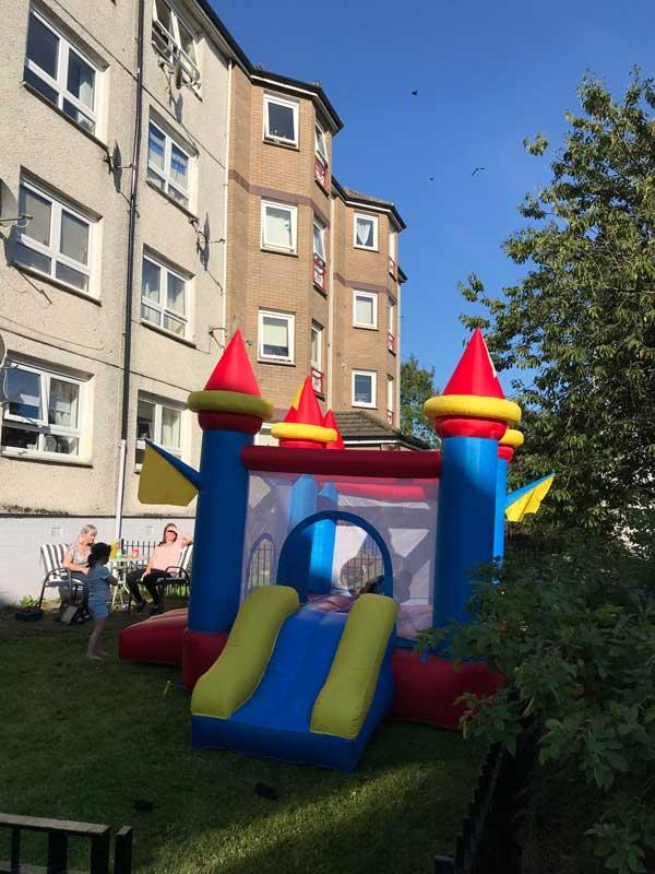 Bouncy castle in front garden of tenemant flat